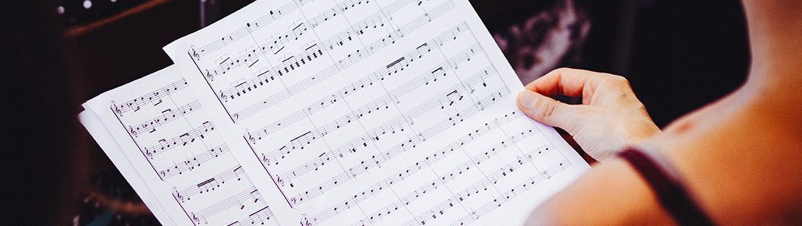 A female musician looking at sheet music
